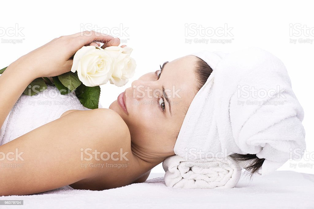 Girl smelling white rose royalty-free stock photo