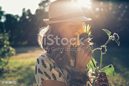 istock Girl smells sunflower 513438122