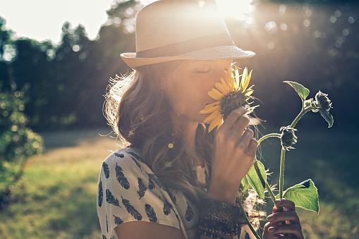 Girl smells sunflower