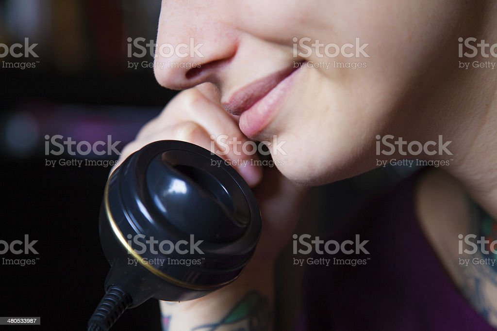 Girl smile at the phone stock photo