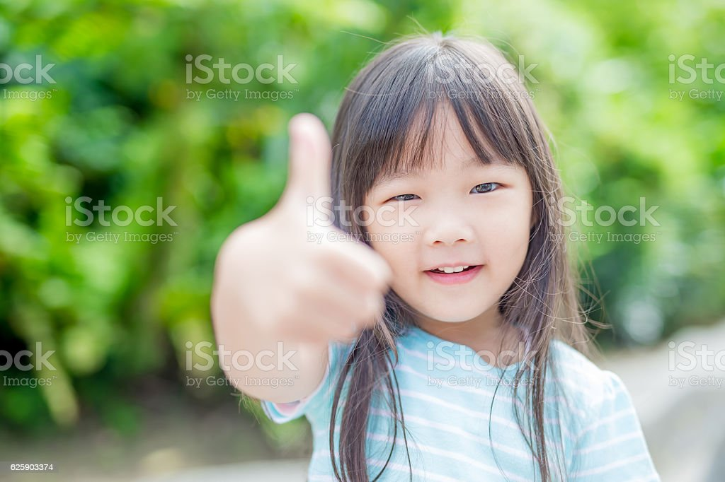 girl smile happily in park stock photo