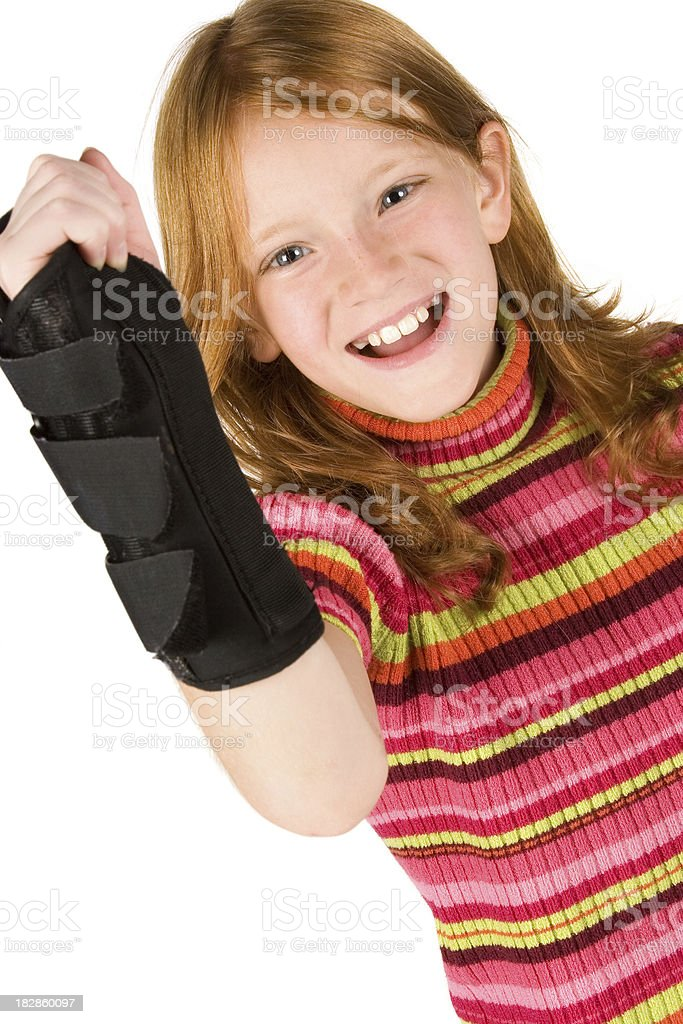 Girl smiles and shows wrist brace stock photo
