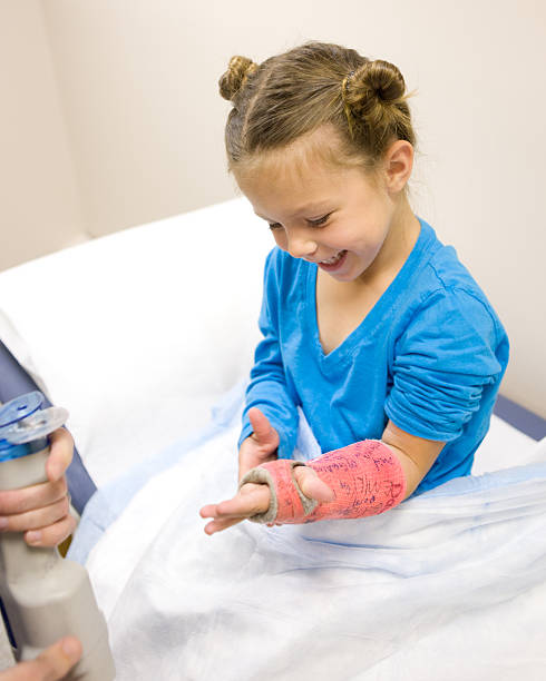 Girl Smiles as Cast is About to Come Off (Series) stock photo