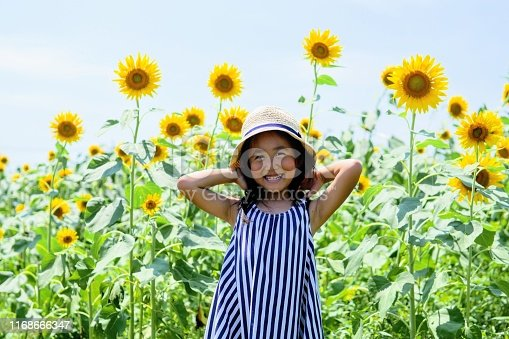 Young girl smiles in the sunflower garden japan