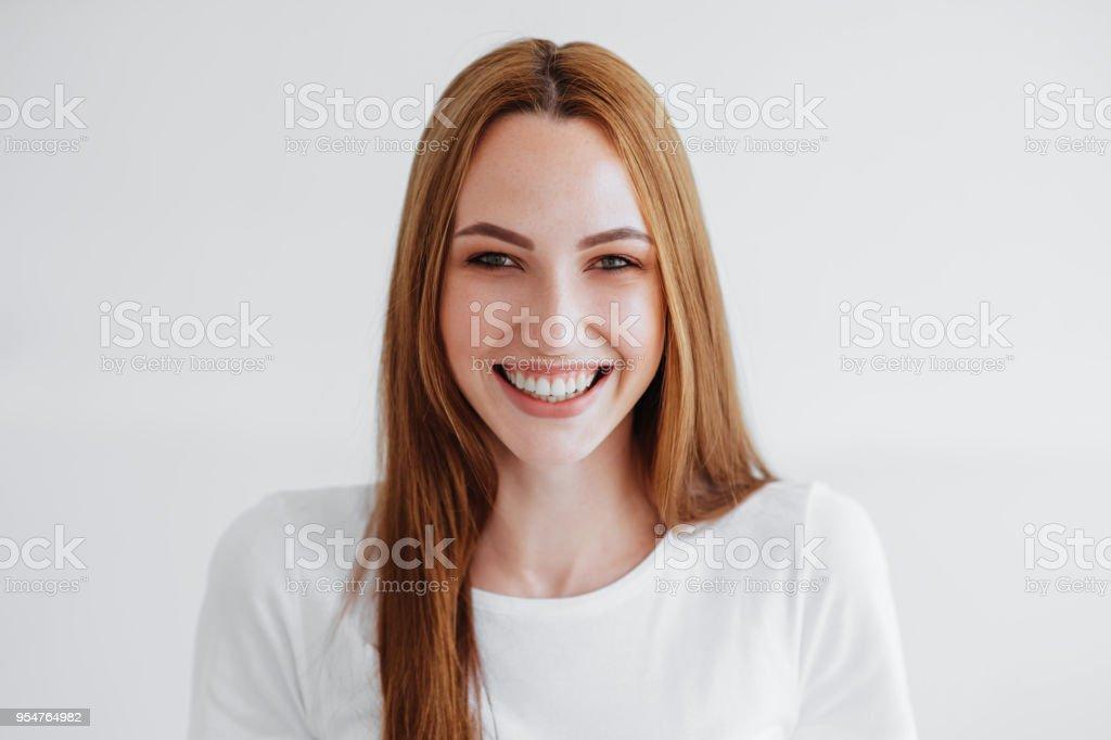 Girl smiles on white stock photo
