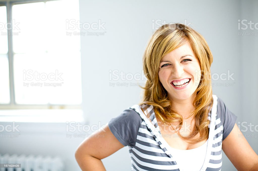 Girl smiling and happy while laughing royalty-free stock photo
