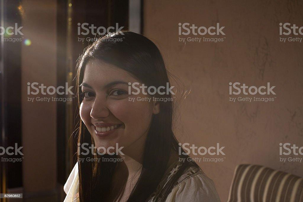 girl smiling in apartment royalty free stockfoto