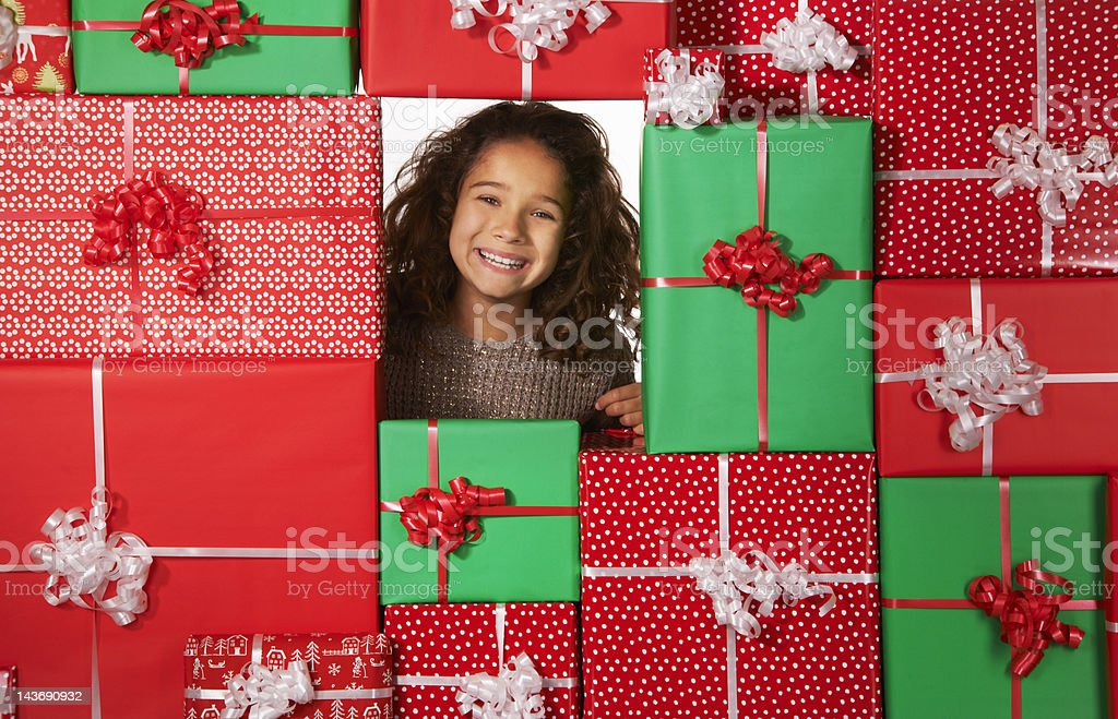 Girl smiling in Christmas gift fort stock photo