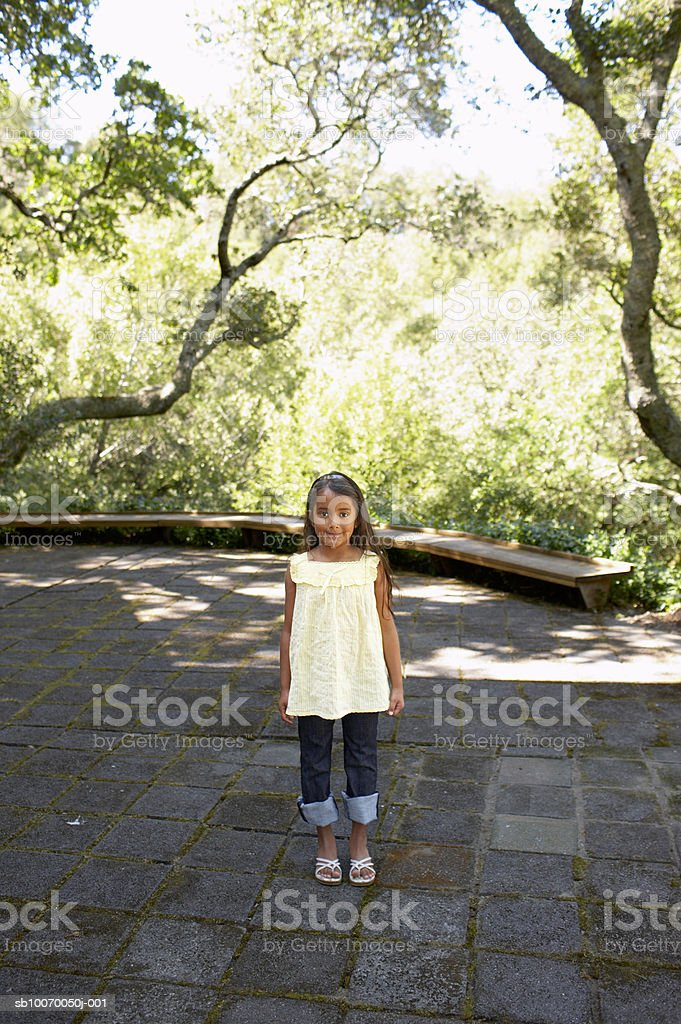 Girl (6-7) smiling, portrait, high angle view royalty-free stock photo
