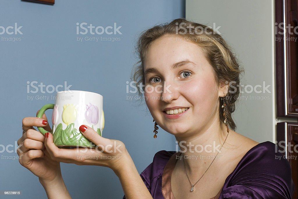 Girl smiling with a cup royalty-free stock photo