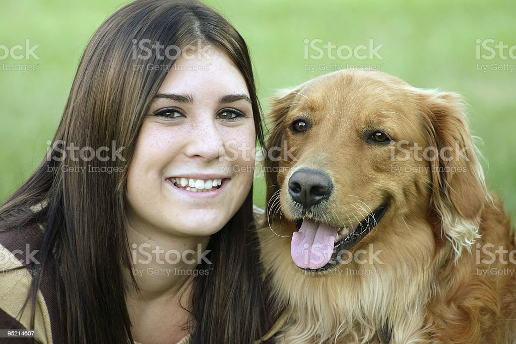 Girl Smiling with Dog royalty-free stock photo