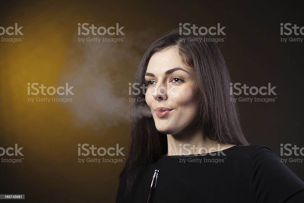 girl smokes a hookah in studio royalty-free stock photo