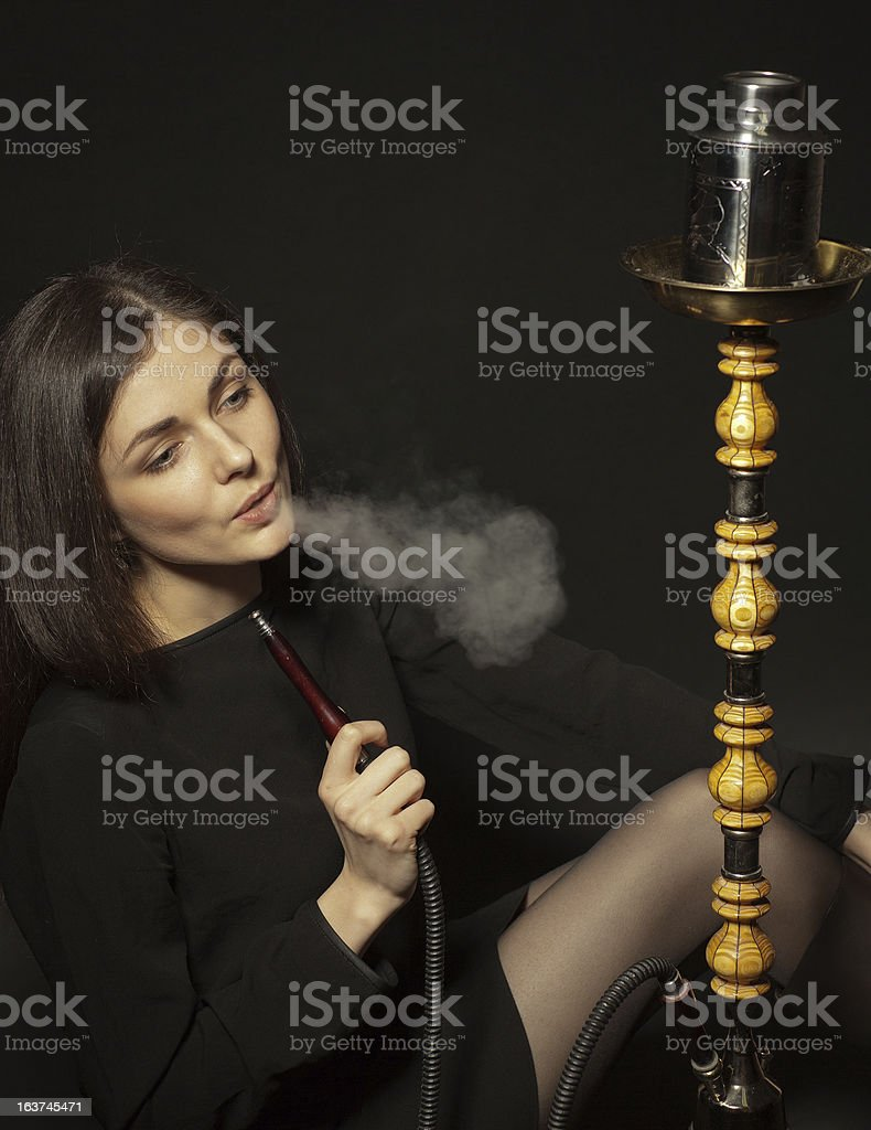 girl smokes a hookah royalty-free stock photo