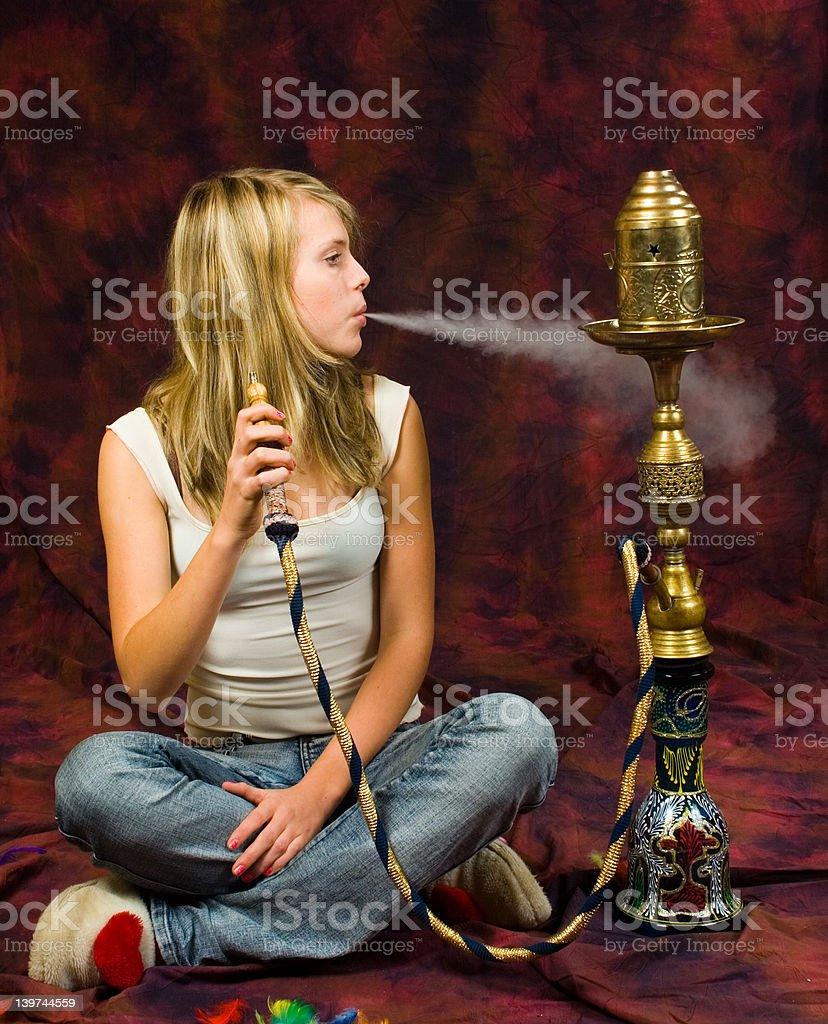 Girl smoking waterpipe royalty-free stock photo