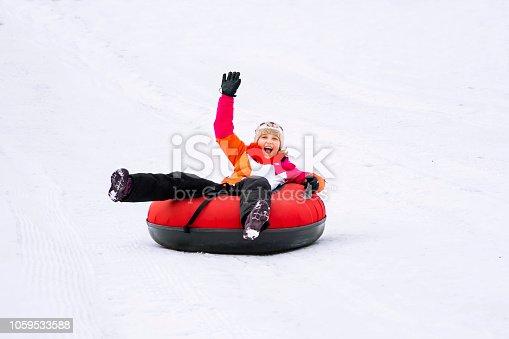 istock Girl Snow Tubes 1059533588