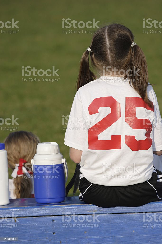 Girl Soccer Player Sitting on Bench royalty-free stock photo