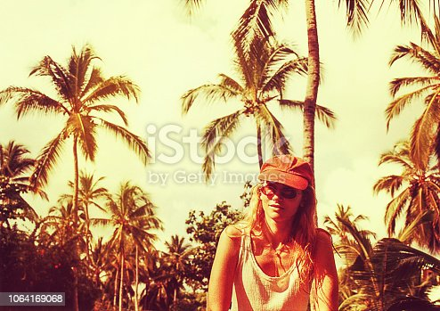 Analog toned image of a young woman on a summer vacation