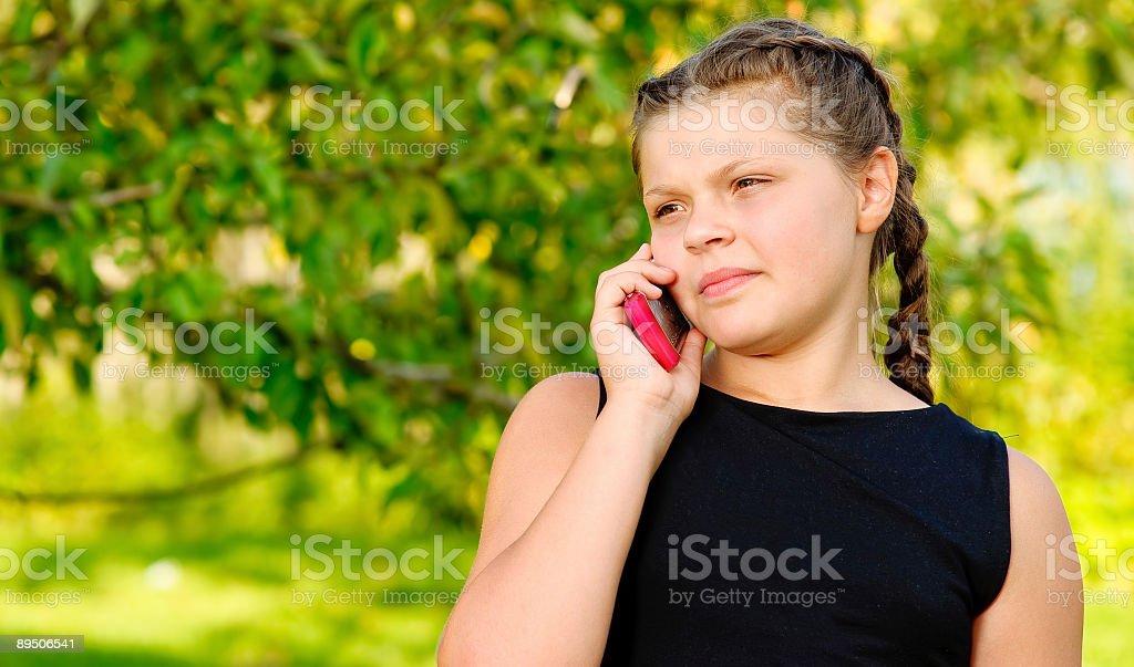 Girl speaks on  cellular telephone royalty-free stock photo