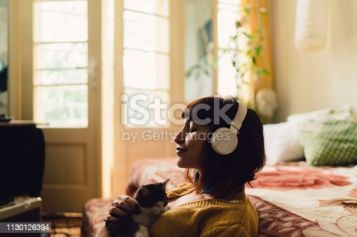 Teenage girl with cat at home relaxing during the weekend