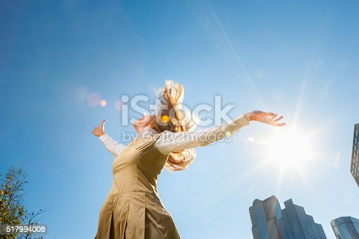 Girl spinning outside in sunshine