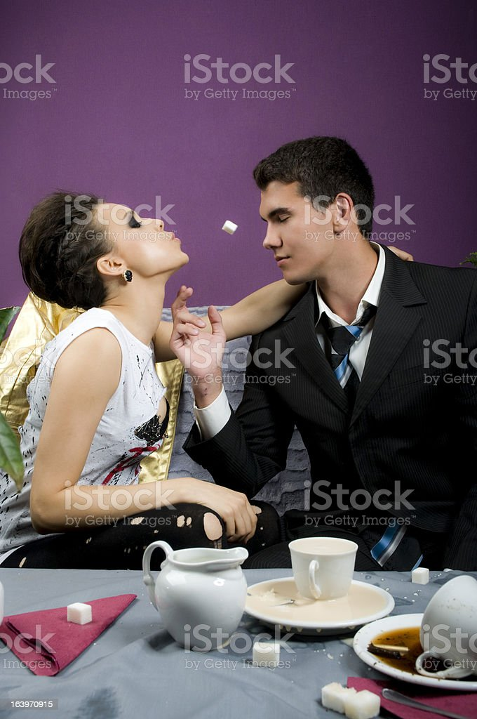 Girl spits in the man a piece of sugar royalty-free stock photo