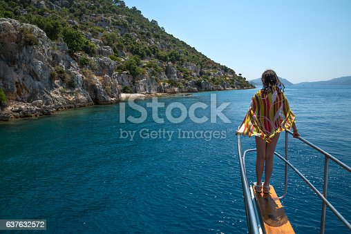 girl standing at the bow yacht