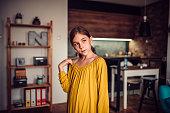 istock Girl standing home in living room 1012535630