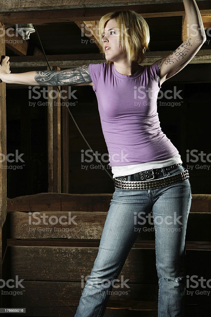 Girl Standing in Barn Looking Off royalty-free stock photo