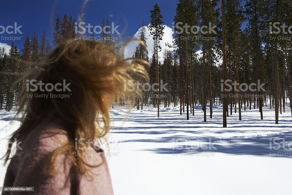 Girl (12-13) standing in snow royalty free stockfoto