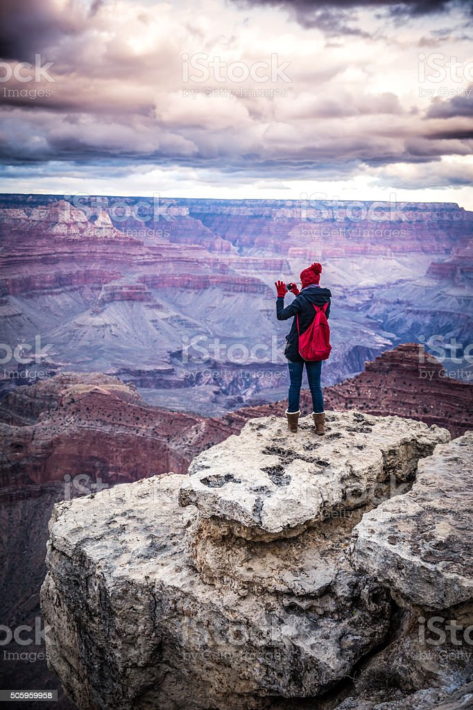 girl standing in the Grand Canyon stock photo
