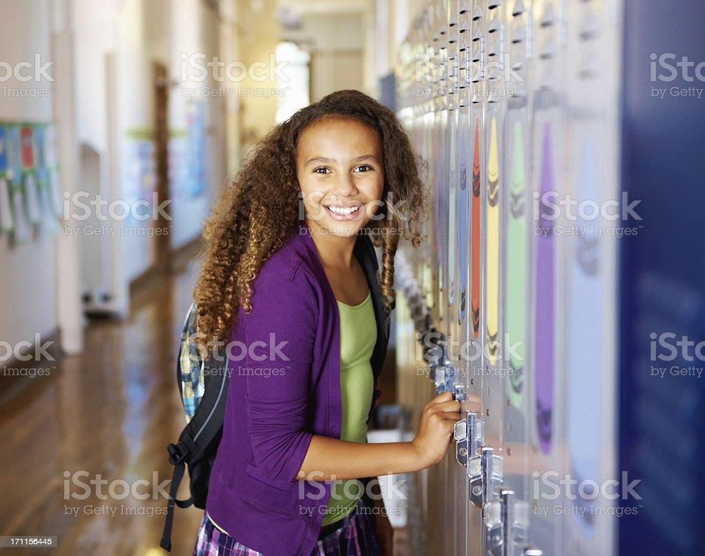 Girl standing near the locker royalty-free stock photo
