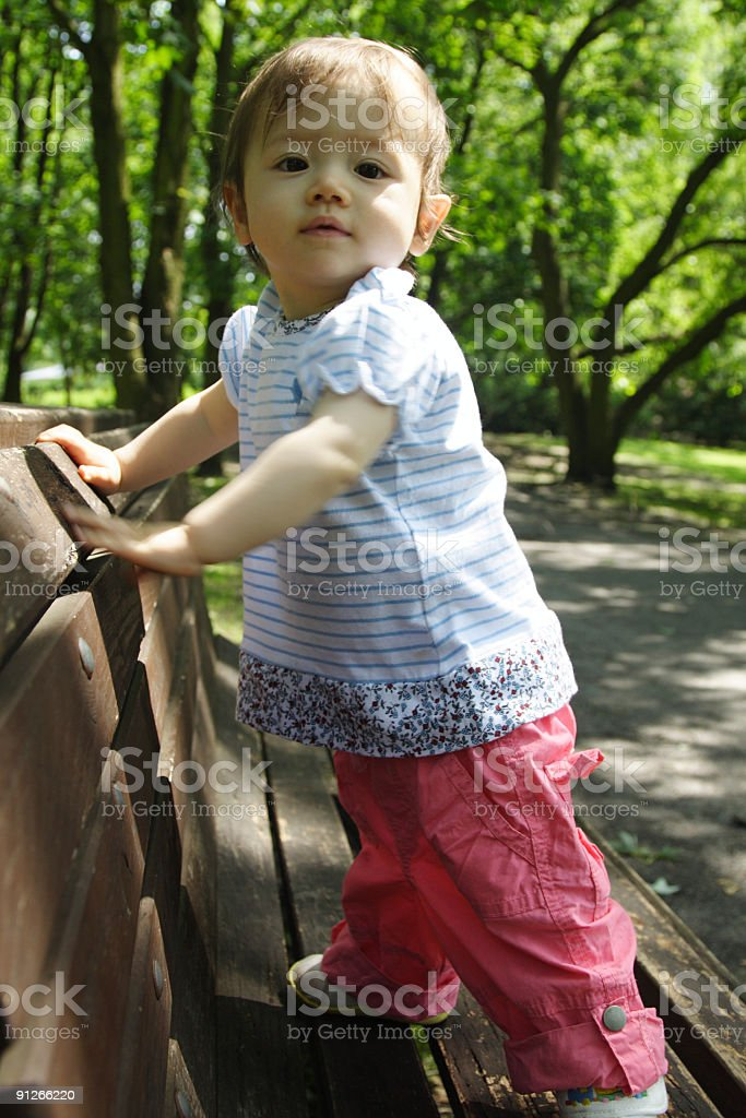 Girl standing on bench royalty-free stock photo
