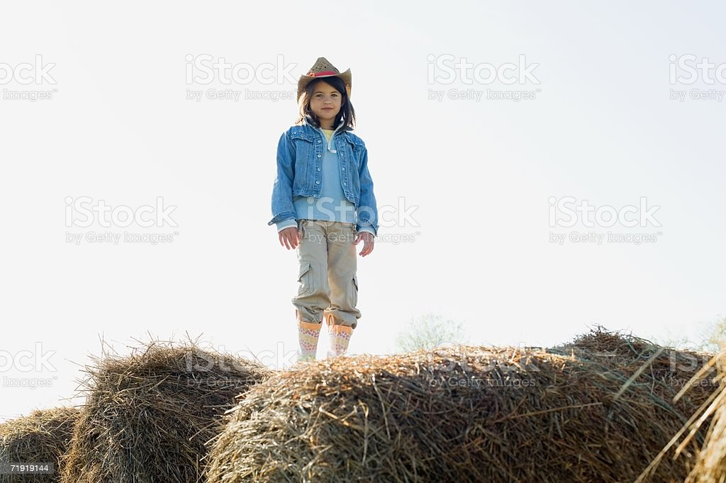 Girl standing on hay stack royalty-free stock photo