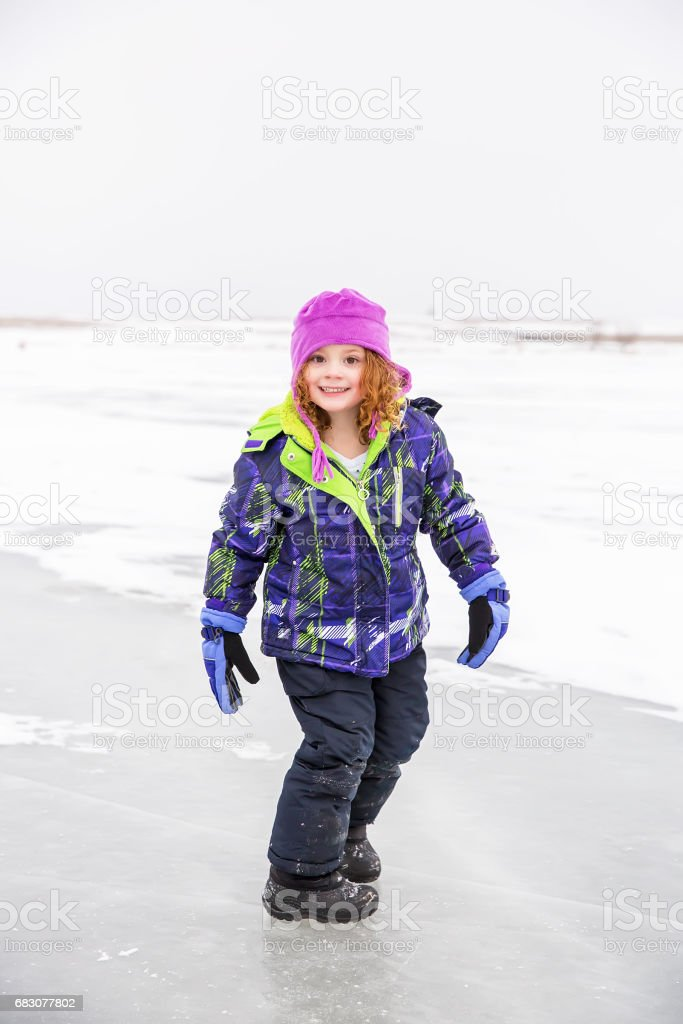 Girl Standing On Ice In Winter Smiling At Camera zbiór zdjęć royalty-free