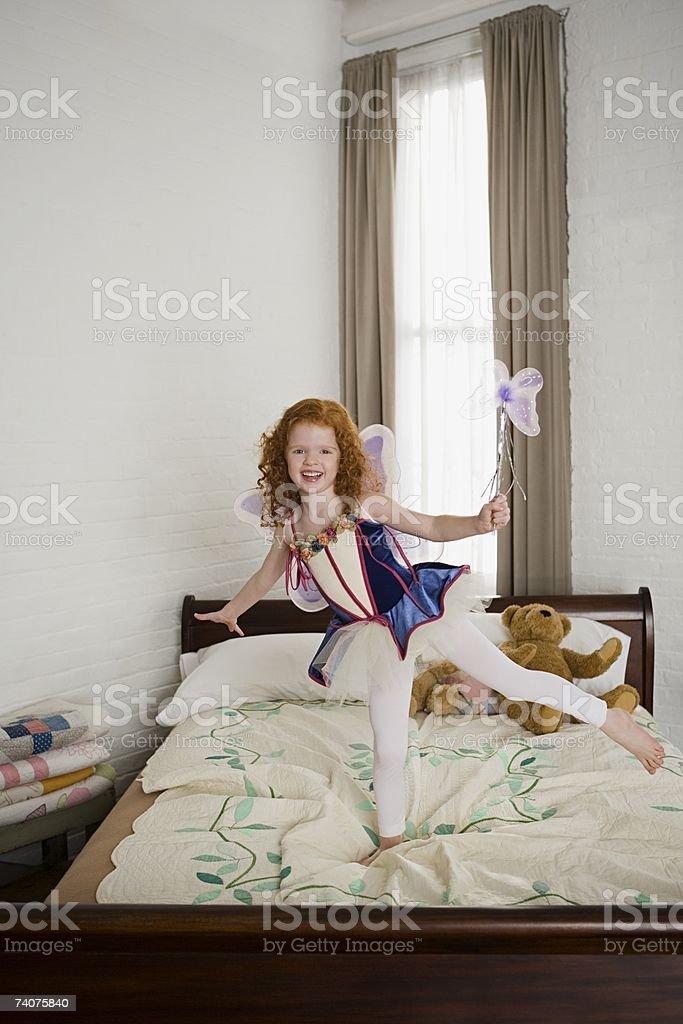 Girl standing on one leg