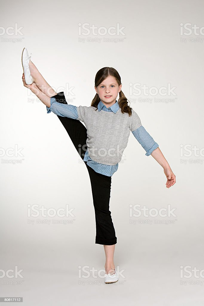 A girl standing on one leg 免版稅 stock photo