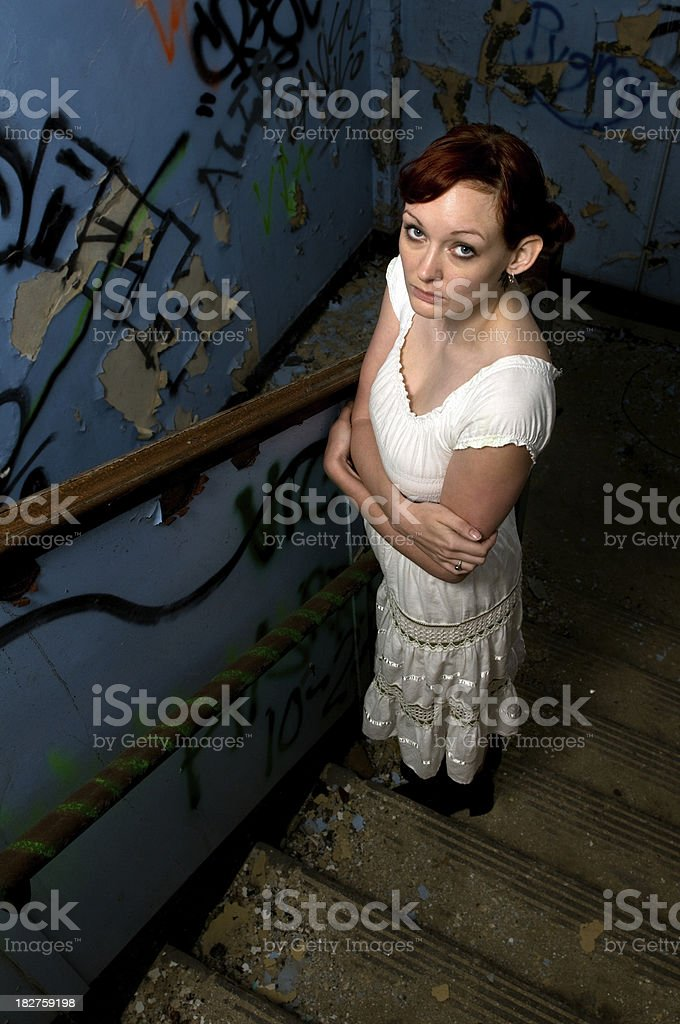 Girl standing on staircase royalty-free stock photo