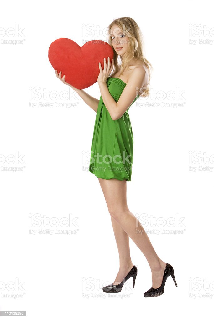 Girl standing with big red heart. royalty-free stock photo