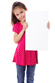 """""""Smiling girl standing with empty vertical blank paper in hands, isolated on white"""""""