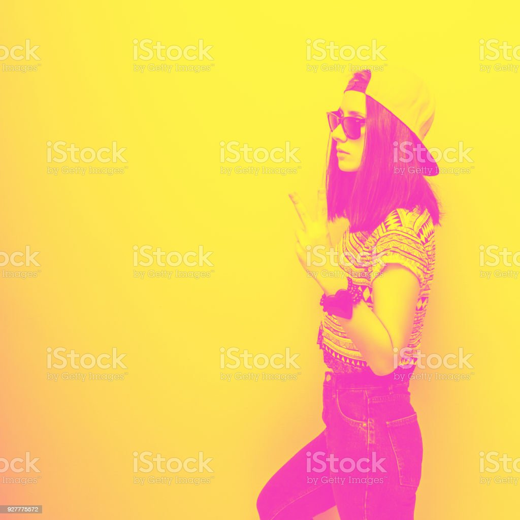 Girl stands sideways and shows the peace stock photo