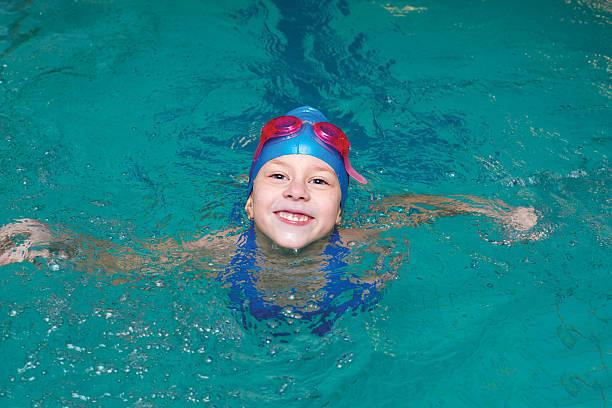 girl start to swimming pool stock photo