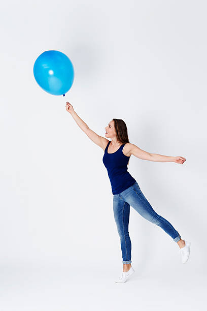 girl starts to float - ballonhose stock-fotos und bilder