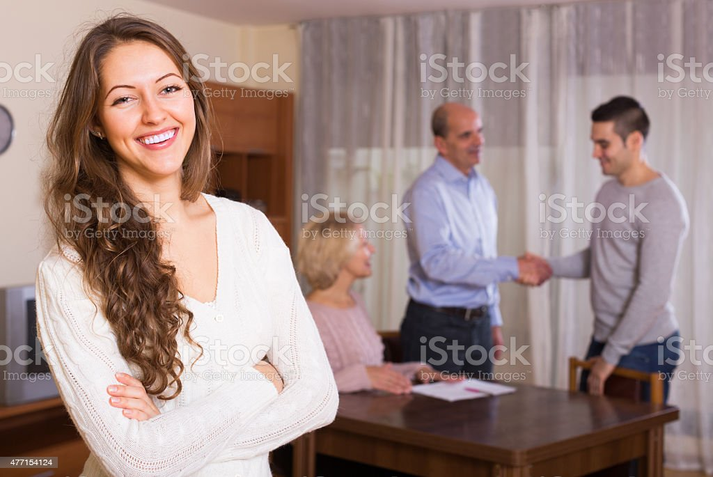 Girl staying near family members stock photo