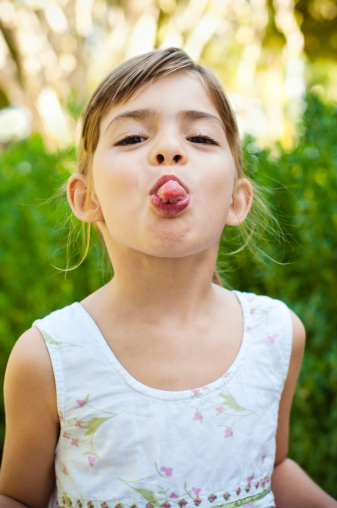 Girl Sticking Her Tongue Out Stock Photo - Download Image