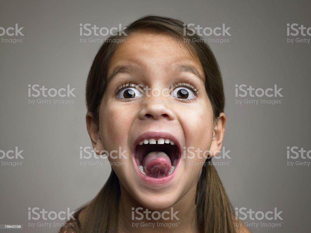 Dziewczyna Wystawiać język zbiór zdjęć royalty-free