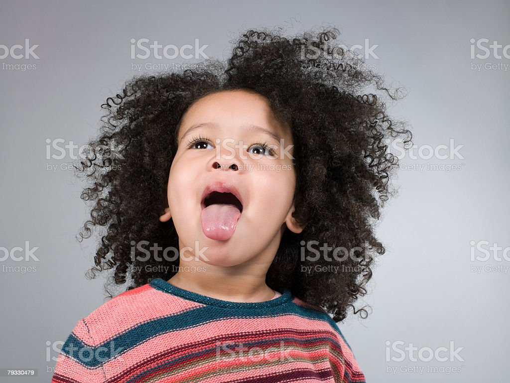Girl sticking tongue out 免版稅 stock photo