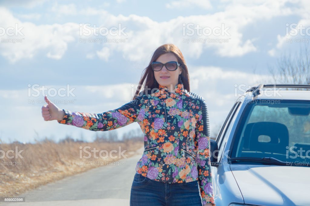 girl stops the car, holding up a hand stock photo