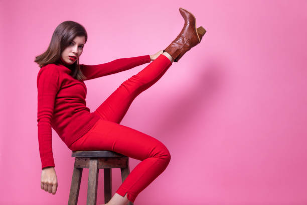 girl straightened her beautiful booted foot stock photo