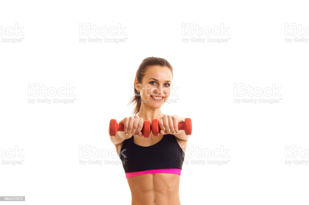 girl stretched forward two hands with pink dumbbells royalty-free stock photo