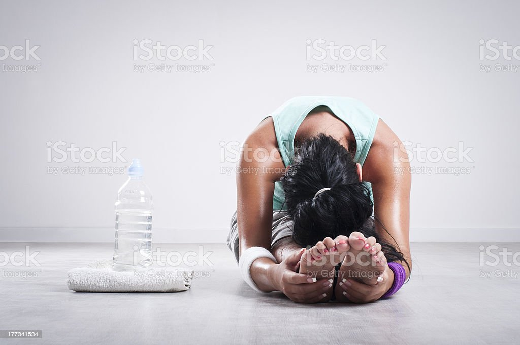 Girl stretching after workout royalty-free stock photo